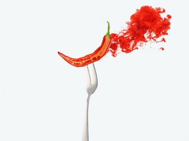 half of red chili pepper on fork and red ink isolated on white