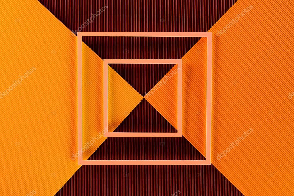 Top view of arrangement of colorful paper sheets and frames backdrop