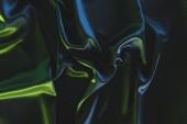 Fotografie plnoformátový tmavé elegantní hedvábné tkaniny jako pozadí