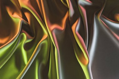 toned picture of elegant folded silk fabric background