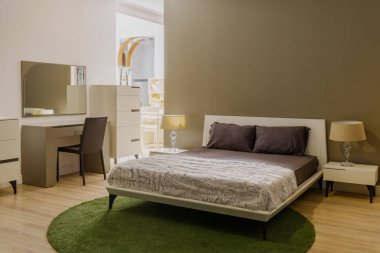 Light bedclothes on bed in cozy bedroom
