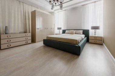 Large bed in modern renovated bedroom