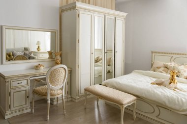 Elegant dressing table by bed in stylish room