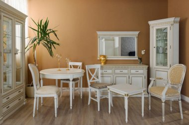 White furniture in elegant dining room