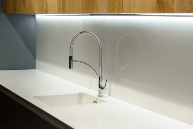 Close-up view of white sink in renovated kitchen