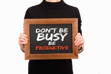 Cropped image of woman holding wooden board with inscription dont be busy be productive isolated on white