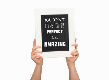 Cropped view of woman holding chalkboard with inscription you dont have to be perfect to be amazing isolated on white
