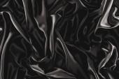 celoobvodové černé elegantní hedvábné látky jako pozadí