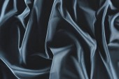 Fotografie close up view of crumpled dark blue silk fabric as background
