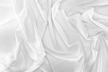 close up view of white soft silk fabric as backdrop