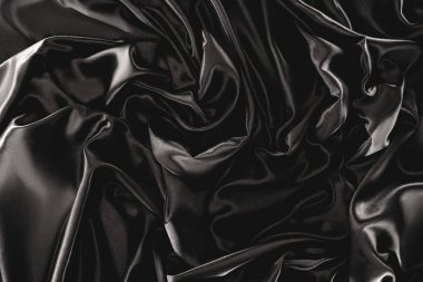 full frame of black elegant silk cloth as background