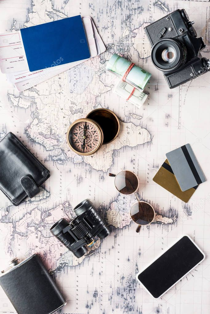 Top view of messy variation of travel attributes on map stock vector