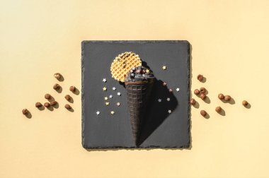 top view of black ice cream on yellow