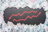 increase and recession arrows in frame of dollar, euro and ruble banknotes on black background