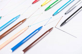colorful felt-tip pens on white background with connected drawn lines, connection and communication concept
