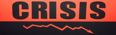 panoramic shot of word crisis and recession arrow on black and red background divided horizontally