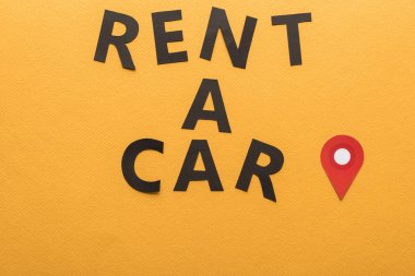 Top view of paper cut rent a car lettering with location mark on orange background stock vector