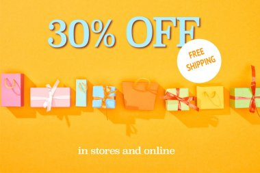 Top view of shopping bags and gifts on bright orange background with 30 percent off sale illustration stock vector
