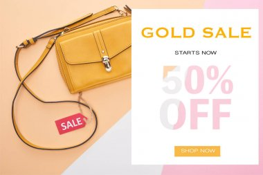 top view of bag with sale label on beige, white and pink background with gold sale 50 percent off illustration
