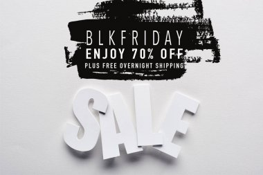 Top view of white sale lettering on white background with black Friday, 70 percent off illustration stock vector