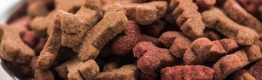 Close up view of fresh dry pet food in bones shape, panoramic shot stock vector