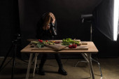 Photo professional photographer making food composition for commercial photography and taking photo on digital camera