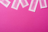 top view of wax depilation stripes on pink background
