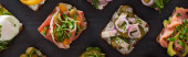 panoramic shot of danish smorrebrod sandwiches with herring fish and salmon on grey  surface