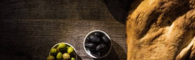 top view of delicious pita and olives on wooden rustic table, panoramic shot