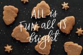 top view hópehely és karácsonyfa cookie-k fekete fa asztal minden szórakoztató minden fényes illusztráció