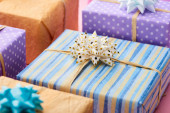 Photo selective focus of stripped present near colorful gifts