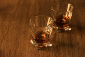 Two glasses of brandy on wooden table