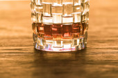 Photo Brandy in textured glass on wooden table