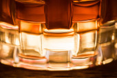 Close up view of brandy in textured glass