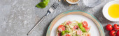 Fotografie top view of cooked Pappardelle with tomatoes, basil and prosciutto near ingredients and fork on grey surface, panoramic shot