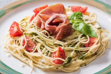 Close up view of cooked Pappardelle with tomatoes, basil and prosciutto stock vector