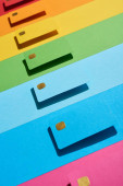 multicolored empty credit cards on rainbow background