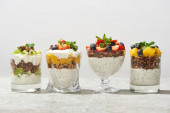 Fotografie delicious granola in glasses with fruits and berries isolated on white