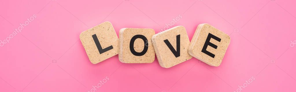Top view of love lettering on wooden cubes isolated on pink, panoramic shot stock vector