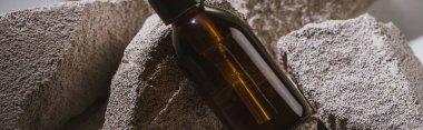 Dispenser cosmetic bottle on rocks, panoramic shot stock vector