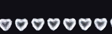 Top view of heart shaped candies isolated on black with copy space, panoramic shot