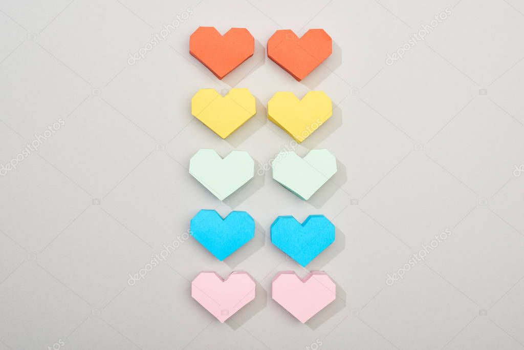 Top view of decorative paper hearts on grey background stock vector