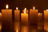 selective focus of burning candles glowing in dark