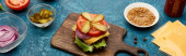 Photo fresh burger ingredients on blue textured surface, panoramic shot