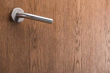 Wooden hotel room door with metal handle stock vector