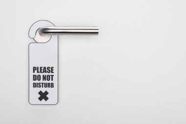 Please do no disturb sign on handle on white background stock vector