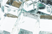 Photo close up view of melting transparent clear square ice cubes