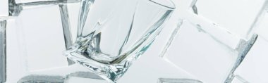 Top view of transparent clear square ice cubes and empty glass on mirror, panoramic shot stock vector