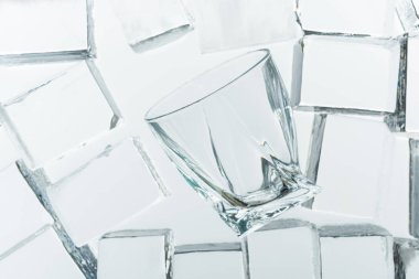 Top view of transparent clear square ice cubes and empty glass on mirror stock vector