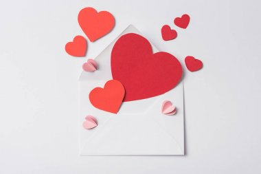 Top view of red hearts and envelope on white background stock vector